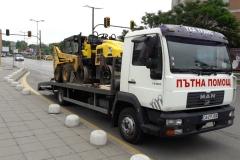 Транспорт на мини-челен товарач и валяк